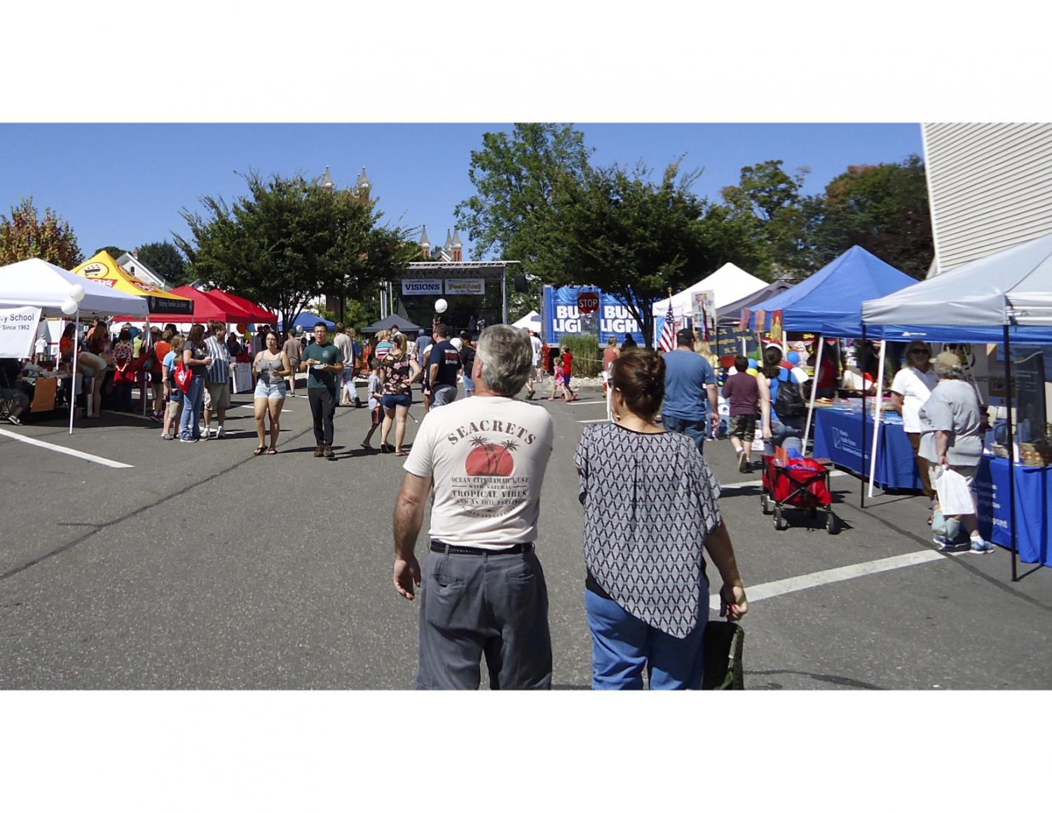 Vendors lined up and down the sides of local parking lot, giving the festival goers freedom to roam and explore the various stations. (Photo by Kassidy Vargas)