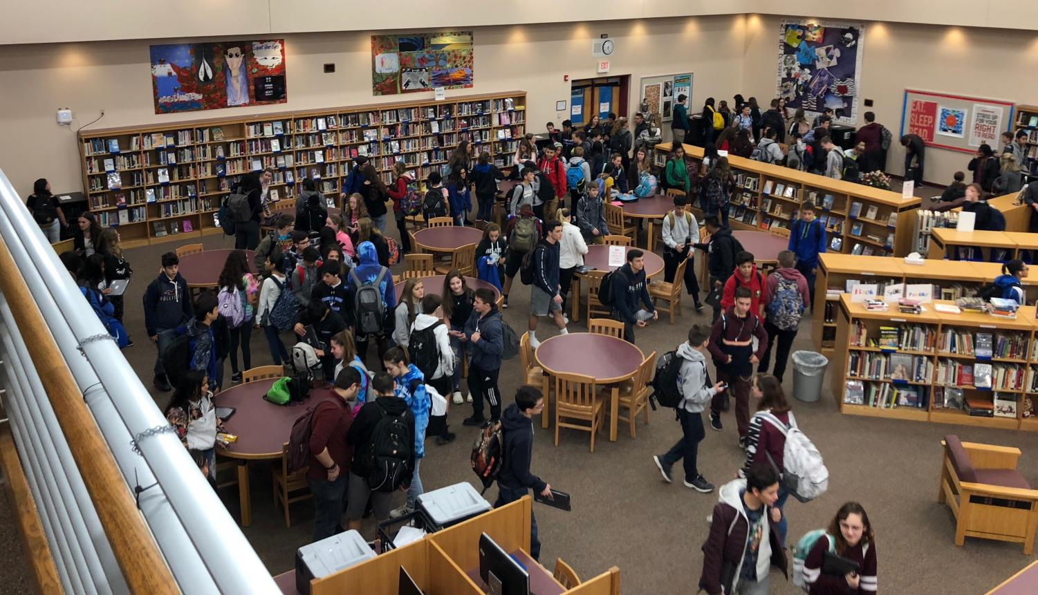 At the beginning of each school day, students can be seen picking up their respective Chromebooks. Once the school day is over, students put their laptops back in the library where they are stored, ready to be used again for the next day. (Photo by Aidan McHenry)