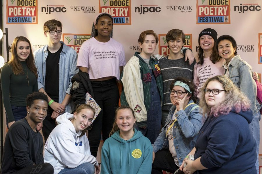 """Warren Hills students pose for a group shot at the 2018 Dodge Poetry Festival. Junior Elisha Stenger said, """"Poetry is healing because sometimes you have to destroy something to put it back together, like breaking a bone to reset it."""" (Photo Courtesy of Kevin Horn)"""