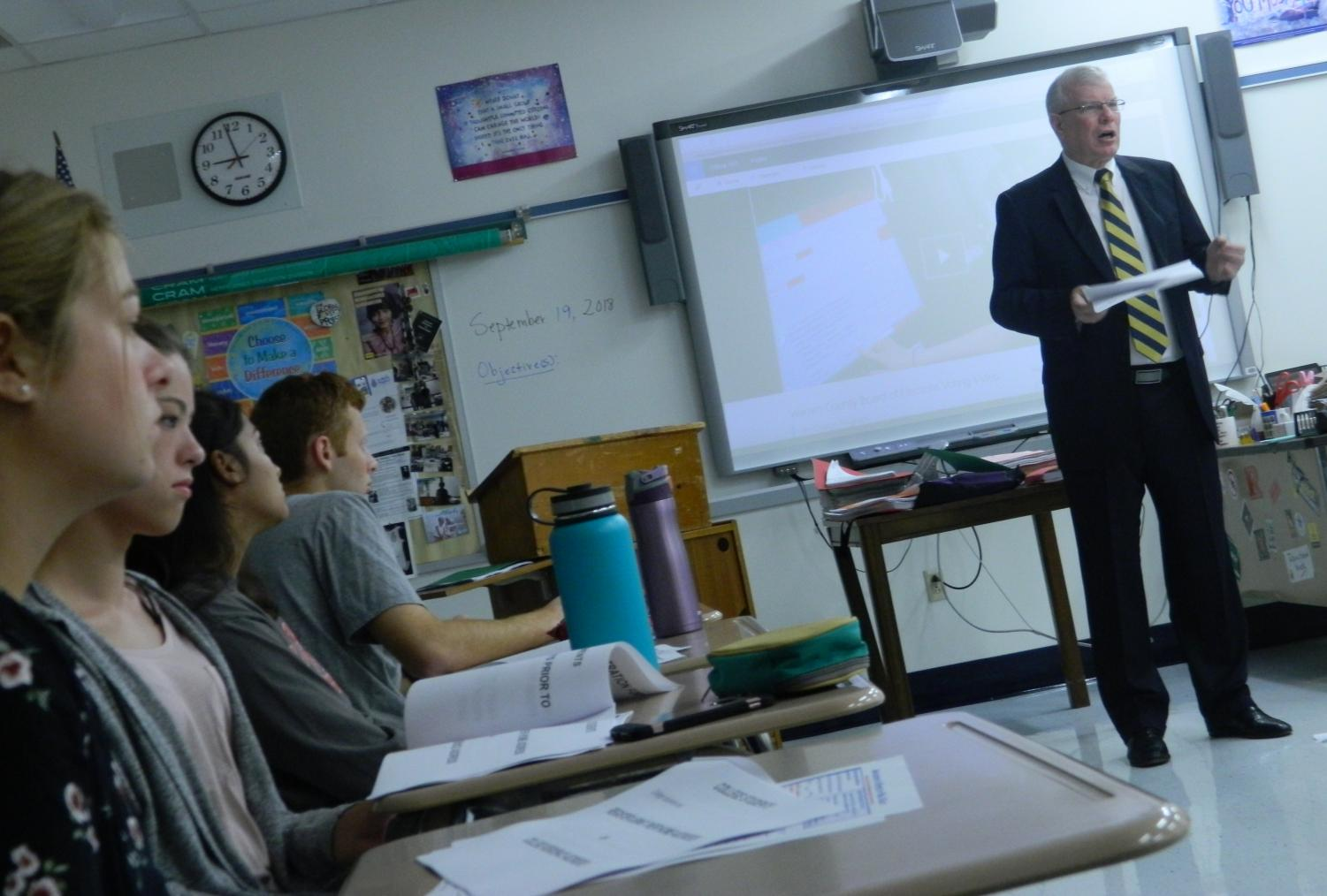 Election Administrator William Duffy walks students through different aspects of the voting registration process. (Photo by Kirsten Dorman)
