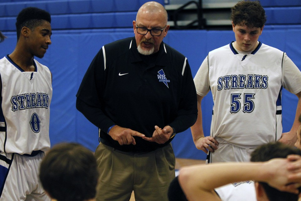 Head Coach Stanley Kubbishun gives his team instructions in the huddle during a timeout in a game versus Voorhees in January of last season. (Photo courtesy of LehighValleyLive)