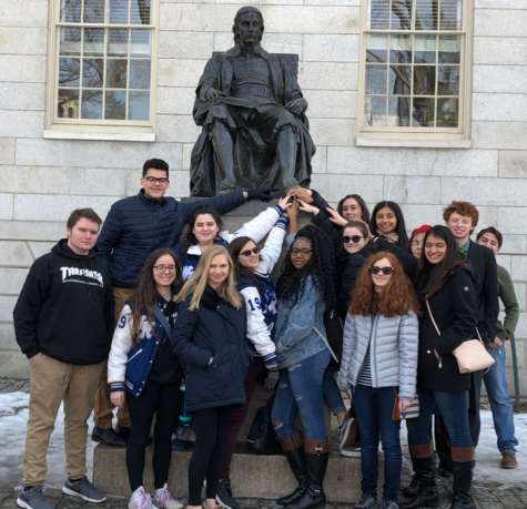 The Debate Team keeps up their tradition with touching Harvard University founder John Harvard's shoe for luck. This proved to not be very lucky, as only one student for Warren Hills, sophomore Samantha Lewis, won an award. (Photo by Penny Giamoni)