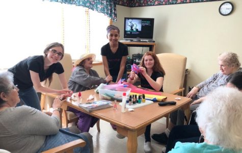 Glamour Gals Bring May Flowers to Seniors