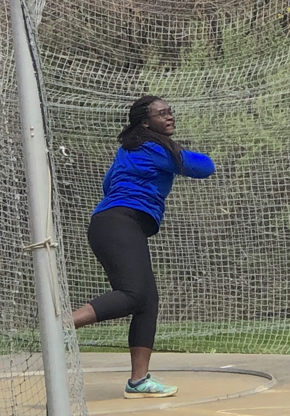Eniola+Ajayi+throws+her+discus+at+the+Randolph+Relays.+%28Photo+by+Hannah+DeVoe%29+