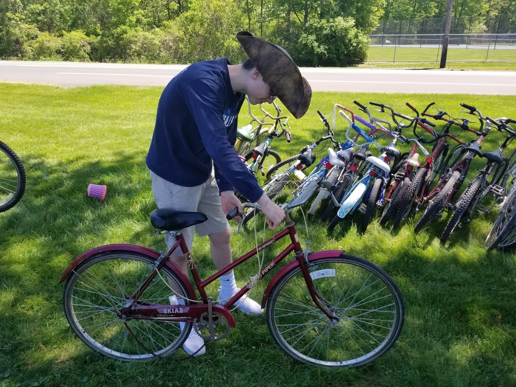 "In early May, Mr. Detrick's Chess Club helped package bikes he collected throughout the year for Pedals for Progress. ""We had our most successful drive to date with 145 bikes, 58 sewing machines and $2126 to help shipping costs to Albania,"" he said. ""We really have some absolutely amazing students. They worked hard for nearly four hours to process all those bikes which included taking off all the pedals, lowering the seat and turning down the handle bars. It was a great day with so many activities going on at the high school."""