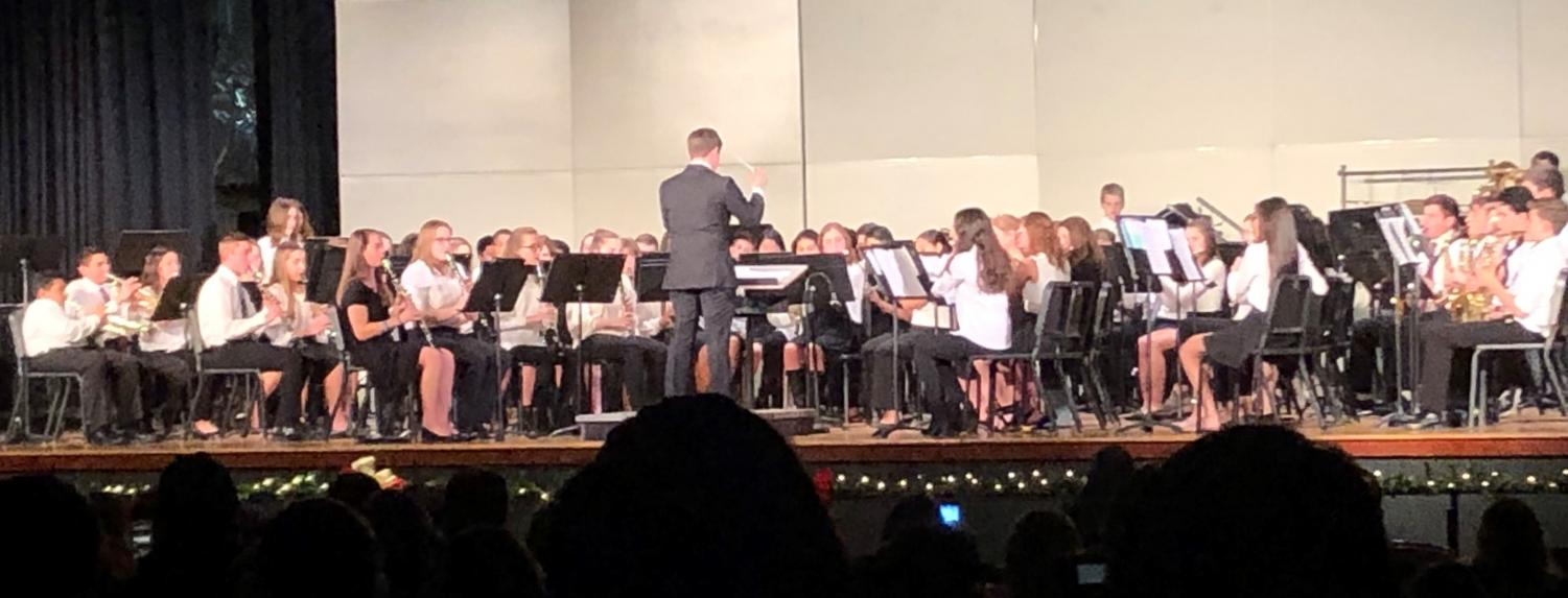 The combined Concert Band and Wind Ensemble, conducted by Band Director Jason Graf, perform at the Fall Concert on Dec. 4 in the Warren Hills Regional High School Auditorium. Band students had been preparing for the Fall Concert since early September, practicing selections such as
