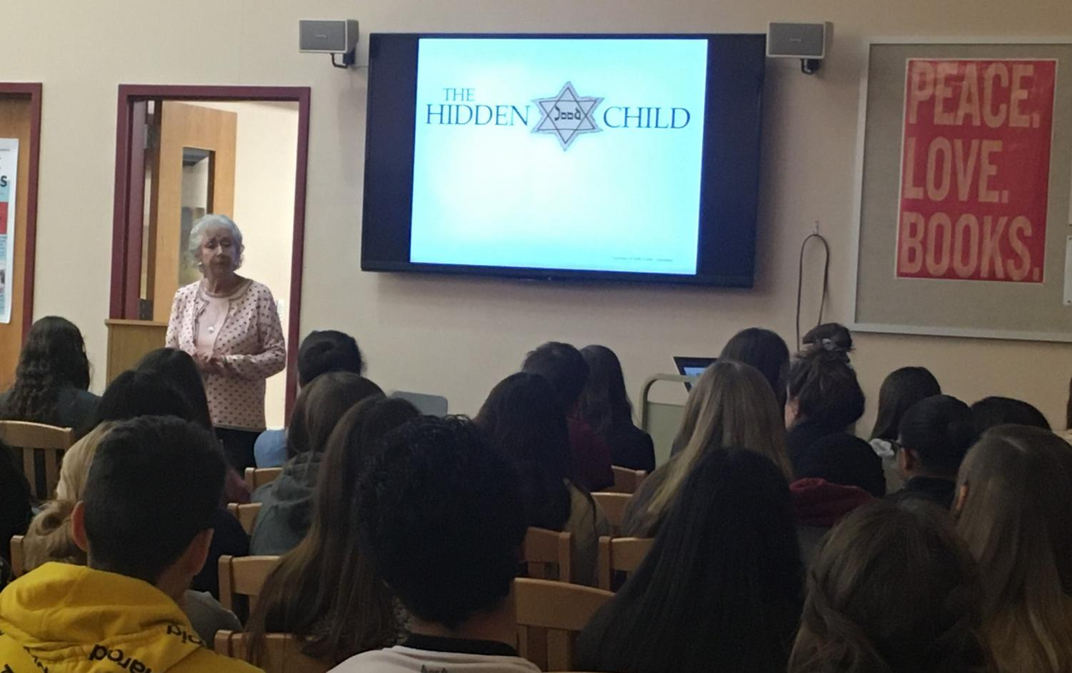 Maud Dahme, a survivor of the Holocaust, shares her story with students at a showcase in the library Nov. 11. (Photo by Stephanie Dunlap)