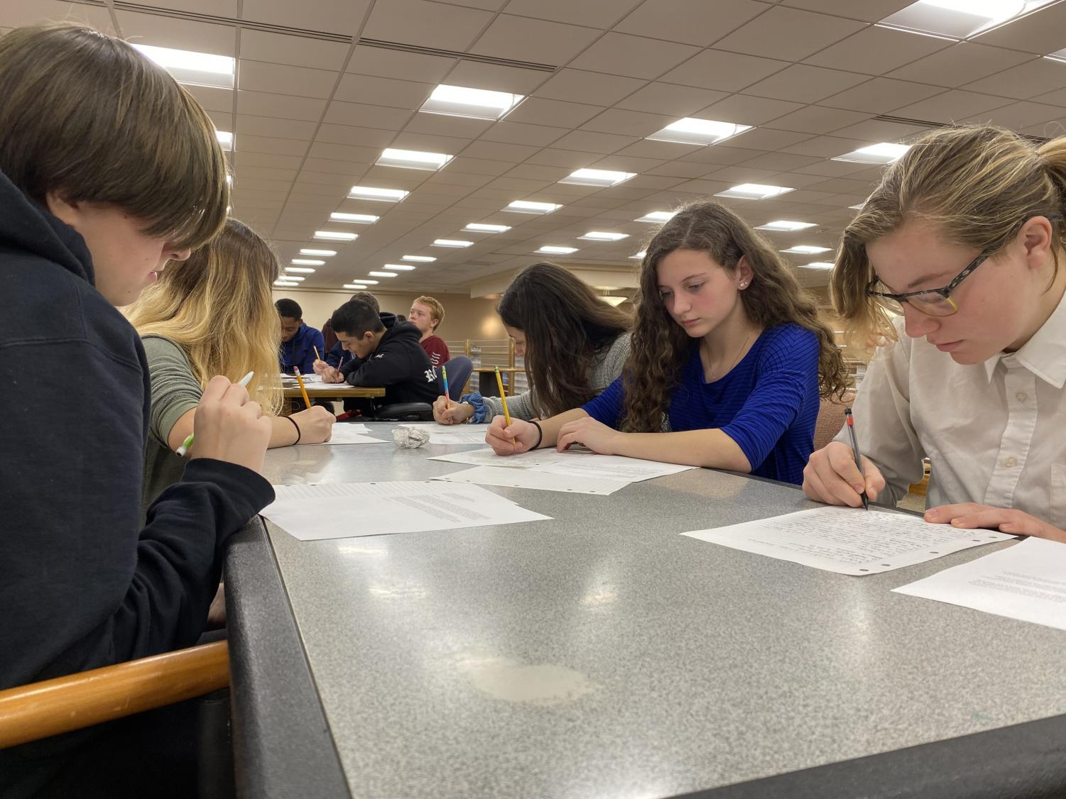 Students write letters for the Write for Rights Campaign at the Human Rights Club library showcase Dec. 10 in recognition of International Human Rights Day. Pictured are (left to right) sophomore Chelsea Sawyer, junior Ashley Wyckoff, and freshmen Tess Errickson, Michelle Perna, and Jennifer Umana. The international Write for Rights Campaign, which began in 2010, sends millions of letters each December to support those whose rights have been violated and to pressure governments into reforming oppressive laws.