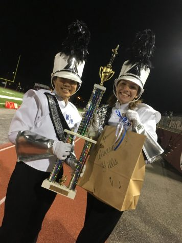 Drum Major Joyce Lin (left) and Assistant Drum Major Emma Sloan (right) showing their eyes with pride at their award. (Photo by Sofia Senesie)