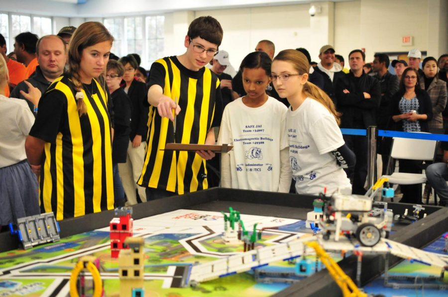 Judges Sarah Korczukowski and Tom Finnegan give feedback to students after a match. (Photo by Elisha Stenger)