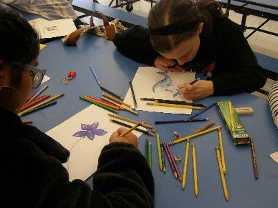 Sixth graders from Oxford draw their own masterpieces during the visual arts workshop.