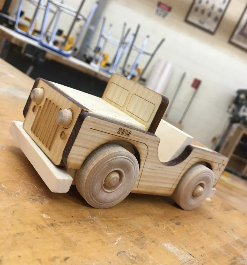 The+Wood+Manufacturing+classes+at+Warren+Hills+created+miniature+Jeep+models+to+sell.+The+students+have+been+making+these+miniature+Jeeps+since+December%2C+and+have+constructed+a+total+of+140.+The+Jeeps+are+being+sold+for+%2412%2C+or+two+Jeeps+for+%2420.+This+was+the+first+major+project+of+the+Wood+Manufacturing+class%2C+which+is+a+new+course+this+year+at+Warren+Hills.+%E2%80%9CThe+kids+worked+hard%2C%E2%80%9D+Wood+Technology+and+Woods+Manufacturing+Teacher+Timothy+Zavacki+said.+%E2%80%9CThis+is+the+first+time+that+we+did+this+and+they+turned+out+really+well.+It%27s+a+new+course+this+year+so+we%E2%80%99re+working+through+the+bumps.%E2%80%9D+%28Photo+by+Stephanie+Dunlap%29