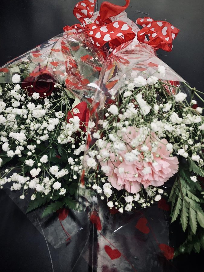 The+Warren+Hills+Floral+Design+class+teamed+up+with+members+of+the+FFA+to+sell+roses+for+Valentine%E2%80%99s+Day+the+week+of+Feb.+9.+The+students+started+with+roses+on+Monday%2C+but+the+preparation+for+the+sale+started+well+before.+Floral+Design+is+a+half-year+course+that+teaches+students+the+art+of+arranging+flowers.+The+FFA+organized+the+sale+with+the+second-semester+Floral+Design+class%2C+who+had+to+organize+the+advertising%2C+sales%2C+and+actual+flower+arrangements.+%E2%80%9CIt%27s+a+great+experience+for+the+students%2C%E2%80%9D+said+FFA+Director+and+Floral+Design+Teacher+Patricia+Smith.+%E2%80%9CFloral+design+is+a+half-year+course%2C+so+the+students+just+started.+They+had+to+jump+right+in+with+both+feet+and+get+started+on+a+promotion+with+a+sale.+They%27ve+been+working+on+marketing+and+they+decided+how+many+flowers+to+order%2C+what+they+were+going+to+do+to+sell+them%2C+and+how+much+they+were+going+to+sell+them+for.+It+was+a+great+experience+for+them.%E2%80%9D+%28Photo+by+Stephanie+Dunlap%29
