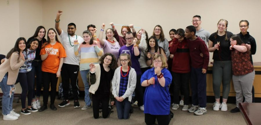 Several+students+showed+off+their+knitted+bracelets+as+Best+Buddies+teamed+up+with+the+Warren+Hills+Knitting+Club+for+an+early+morning+activity+in+the+library+Feb.+10.+The+purpose+of+the+activity+between+the+two+clubs+was+to+foster+fun+and+respect.+%E2%80%9CIt%E2%80%99s+fun+to+interact+with+people+that+I+normally+wouldn%E2%80%99t+interact+with%2C%E2%80%9D+said+Junior+Walker+Heller.+Industrial+Technology+teacher+David+Rader+supplied+equipment+for+the+activity.+%28Photo+by+John+Veneziano%29