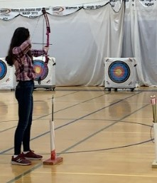 Sophomore Sophia DePol from the Warren Hills Archery program takes aim at a target during a recent practice.  Archery's competitive season against other schools opened Feb. 27. (Photo by Loren Burrows)