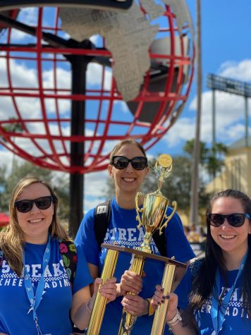 Pictured are Coach Kayla Tietz (left), Coach Elizabeth Horvath (middle) and Coach Kim Yapalola (right) holding the seventh place 2020 Nationals trophy. (Photo courtesy of Elizabeth Horvath).