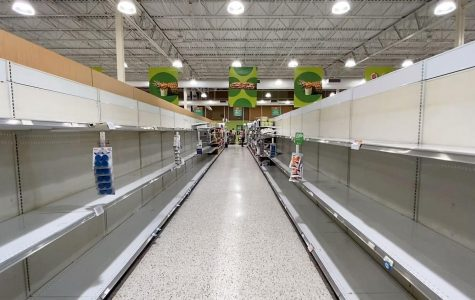"In St. Petersburg, Florida, ""The Northeast Shopping Center Publix had the entire aisle of paper goods, which included paper towels and toilet paper, cleared out by customers at the end of the day Sunday, March 15, 2020."" (JAMES BORCHUCK/Times)"