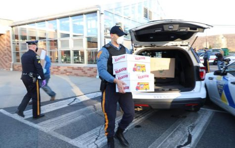 NJ State Police officers picking up over 15,000 face shields to distribute to first responders. (Photo Courtesy of Mr. Daryl Detrick)
