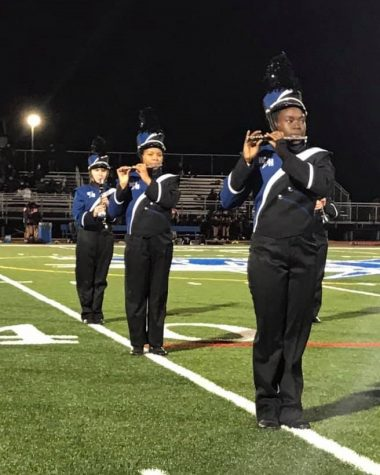 From front to back, pictured are band members Precious Thriiah, Amber Blyd, and Abigail Thomas.