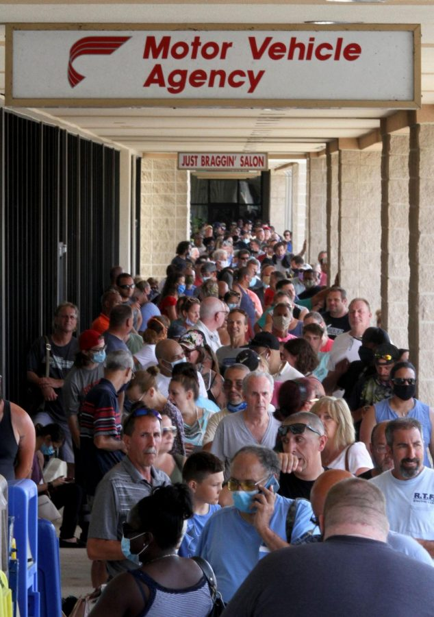 People fill the walkways at the Manahawkin Plaza Tuesday morning, July, 7, 2020, waiting to enter the Motor Vehicle Agency there. Long lines were reported across the state.