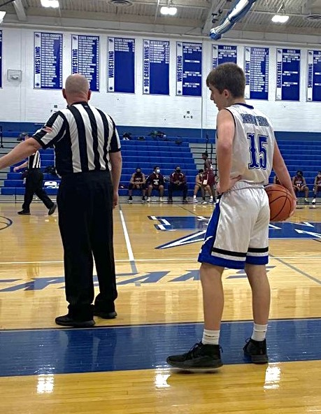 Junior Evan Heine waits for a referee to start play so that he can pass in the ball against North Plainfield during the Blue Streaks' home opening night. The Streaks won 57-43.