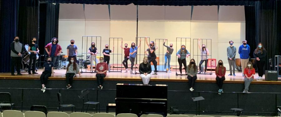 The Warren Hills Drama Club cast of Chicago: High School Edition rehearses six feet apart in the auditorium while wearing masks to adhere to COVID-19 protocols.